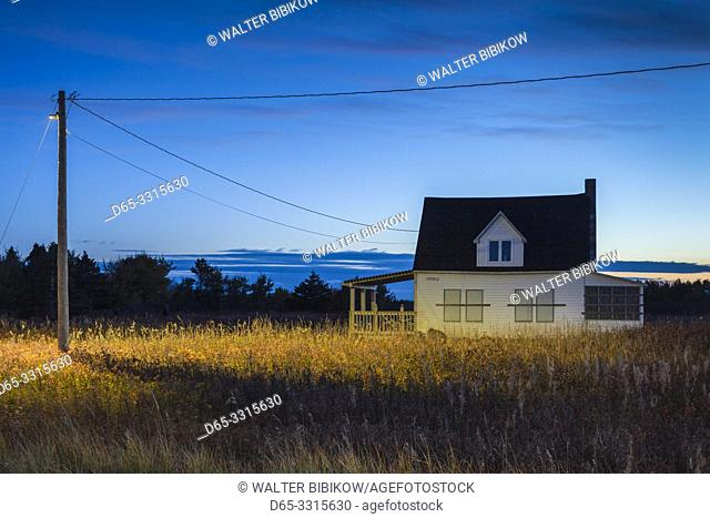 Canada, New Brunswick, Acadian Peninsula, Miscou Island, old house, dusk