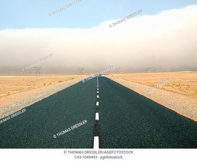 Namibia - The B4 tarred road at the edge of the typical coastal fog that moves inland from the inhospitable coast  East of the seaside town of Lüderitz in the...