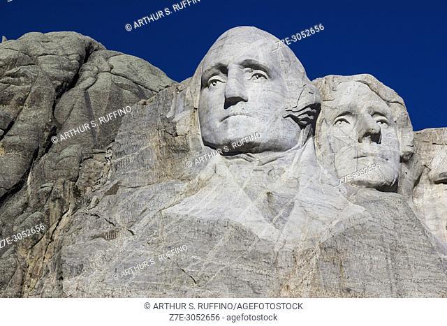 Sculpted faces of Presidents George Washington and Thomas Jefferson. Mount Rushmore National Memorial, Black Hills, Keystone, South Dakota, U. S. A