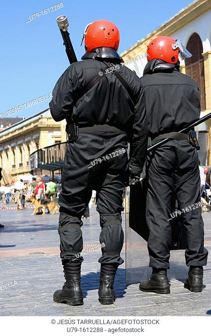 Ertzaintza Riot police watching demonstration in San Sebastián. September 9, 2011. Basque Country, Spain