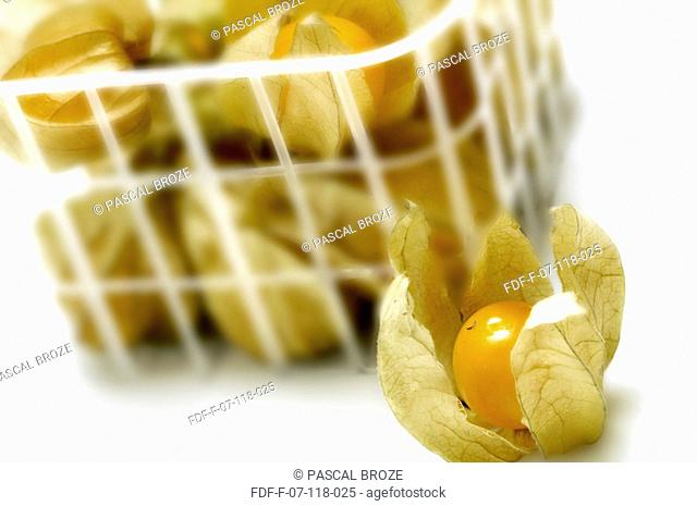 Close-up of a basket of physalis fruit