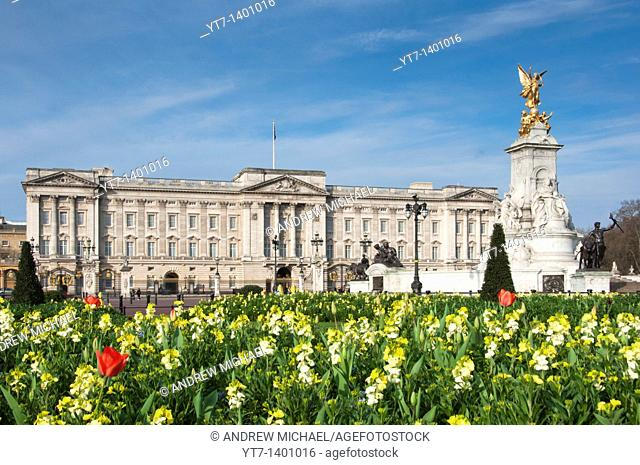 Queen Victoria memorial outside Buckingham palace together with flower beds in the Springtime