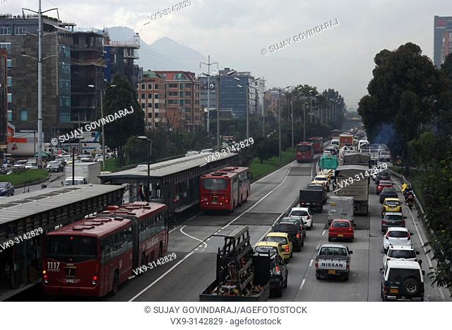 Bogota, Colombia. The traffic on the Southbound carriageway is virtually bumper to bumper. To the left is the TransMilenio station called Calle 127