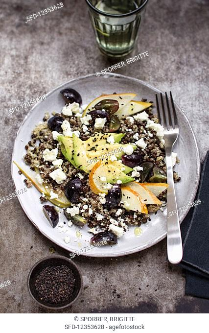 Quinoa and lentil salad with avocado, grapes and pears