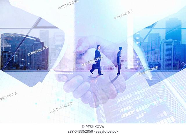 Abstract handshake on meeting city background. Teamwork and meeting concept. Double exposure