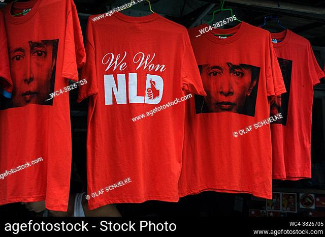 Yangon, Myanmar, Asia - Red t-shirts with the image of Aung San Suu Kyi and the lettering 'We Won NLD' are offered for sale at a street stall in the former...