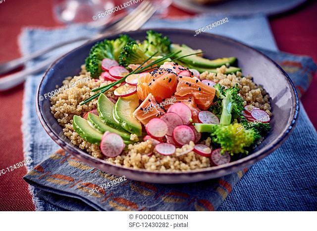 Grain salad with salmon, avocado and broccoli