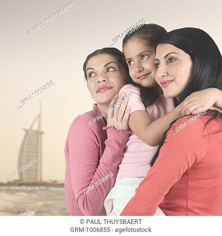 Women and child on the beach in Dubai (with Burj Al Arab hotel in the background)