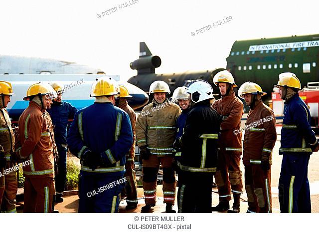Firemen training, large group of firemen listening to supervisor