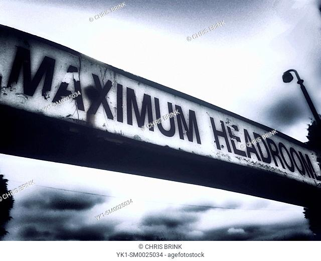 Maximum headroom restriction sign on parking place entrance UK
