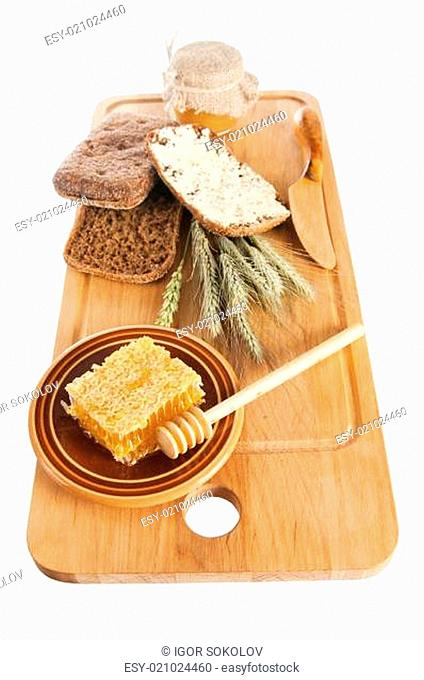 honey, spike and bread on table
