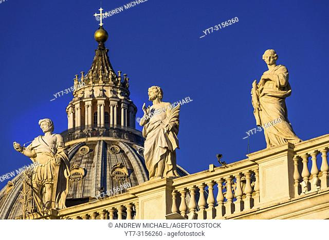 St Peter's Cathedral Cupola and religious statues on St Peter's square, Vatican city, Rome, Lazio, Italy