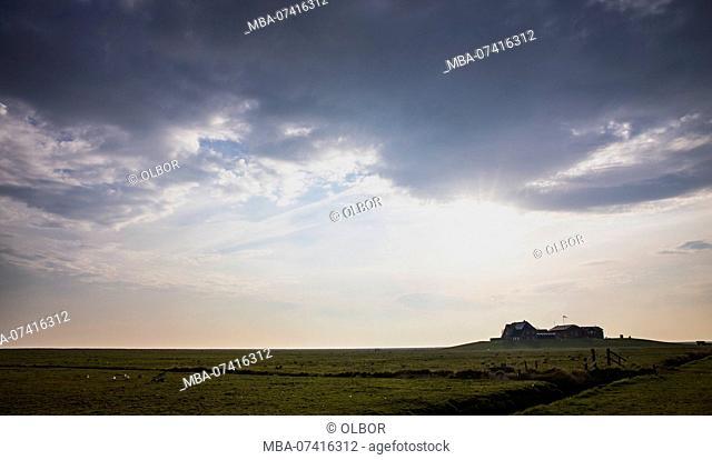 Germany, Schleswig-Holstein, Hallig Hooge, terp in the evening