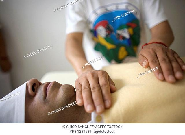 A man receives Reiki in Mexico City, November 23, 2010  Reiki is a spiritual practice developed in 1922 by Japanese Buddhist Mikao Usui  It uses a technique...