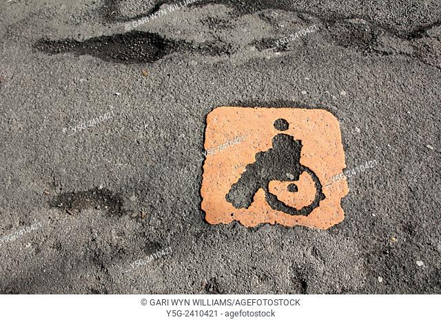 Disabled car parking sign in street road in rome italy