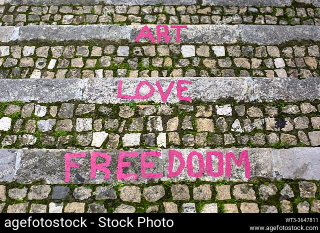 Message words on the stone stairs of the Mouraria neighborhood, LISBON, PORTUGAL, EUROPE
