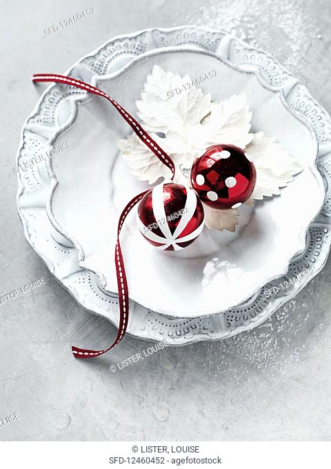 A place setting with Christmas baubles