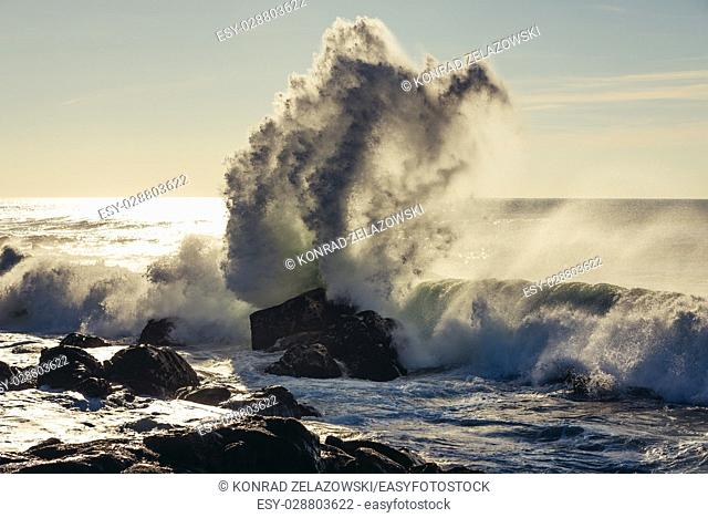 Big waves smashing on rocks of Atlantic Ocean shore in Nevogilde civil parish of Porto, second largest city in Portugal