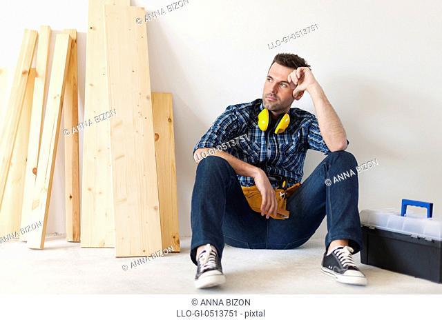 Carpenter relaxing after work. Pilzno, Poland