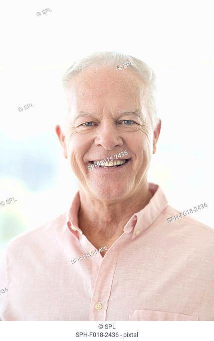 Senior man smiling towards camera