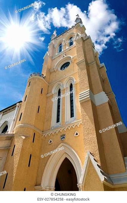 sun rays shining down on christian cathedral with blue sky in Hong Kong