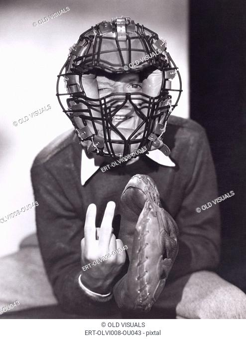Catcher giving curve ball signal (OLVI008-OU043-F)