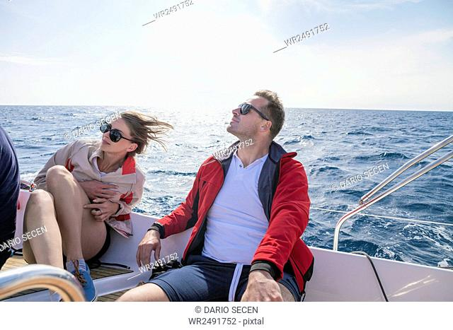 Couple relaxing on sail ship