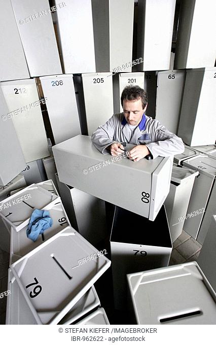 City of Regensburg employee cleaning and checking ballot boxes prior to Federal parliamentary elections on 18/9/2005 in a depot in Regensburg, Bavaria, Germany