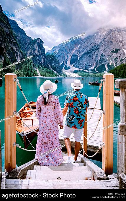 couple visit the famous lake Lago Di Braies Italy, Pragser Wildsee in South Tyrol, Beautiful lake in the italian alps, Lago di Braies