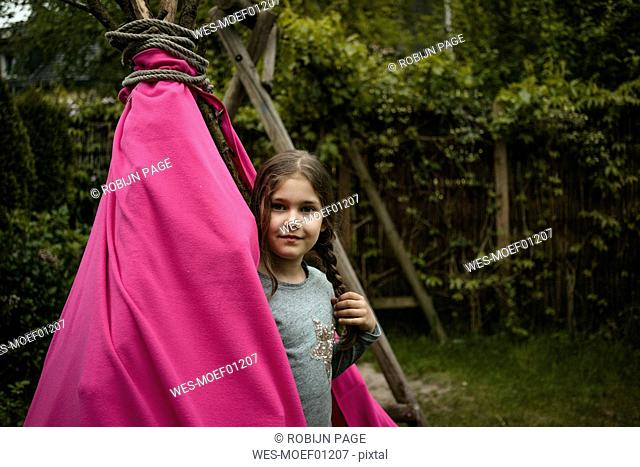 Smiling girl with braid, tipi