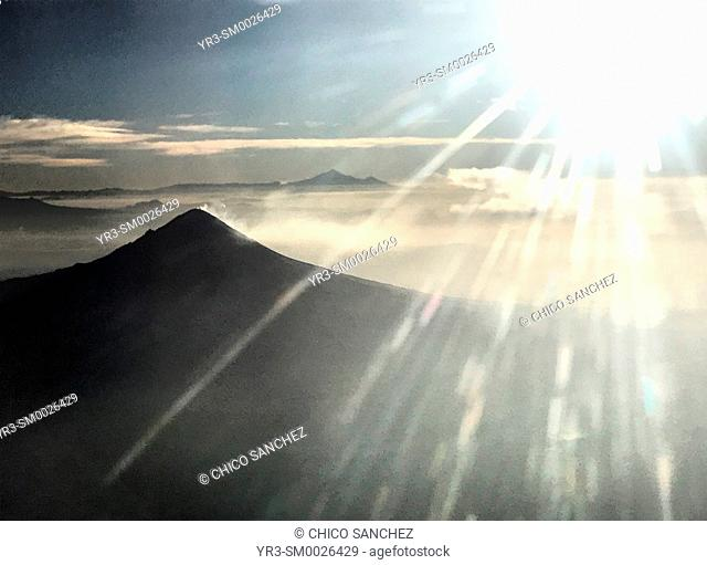 The sun shines in the window of a plane over the Popocatepetl volcano in Puebla, Mexico