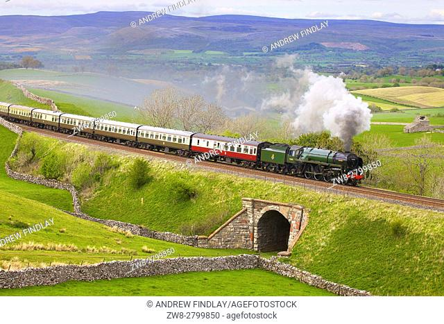 Steam train Britannia on the embankment at Greengate. Kirkby Stephen, Settle to Carlisle Railway Line, Eden Valley, Cumbria, England, United Kingdom, Europe
