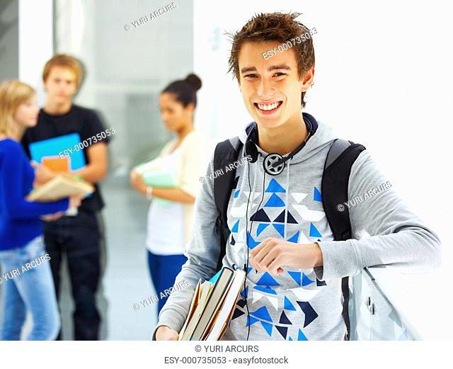 Portrait of a young attractive student at school Classmates in the background
