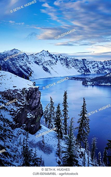 View of snowy mountains and lake, Crater Lake National Park, Oregon, USA