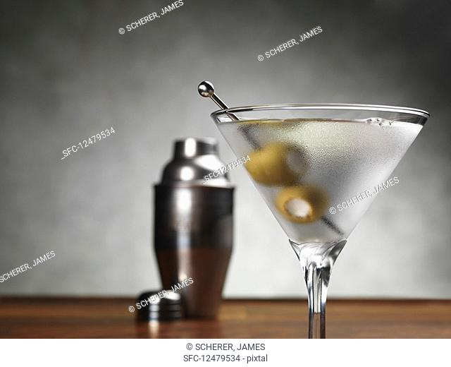 A martini cocktail with olives