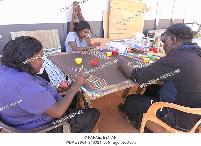 DERBY, WA - SEP 10 2019:Aboriginal artists dot painting.Before Indigenous Australian art was ever put onto canvas the Aboriginal people would smooth over the...
