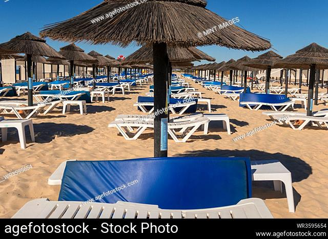 Beach parasols and sunloungers on the beach on Ilha de Tavira, Southern Algarve, Portugal