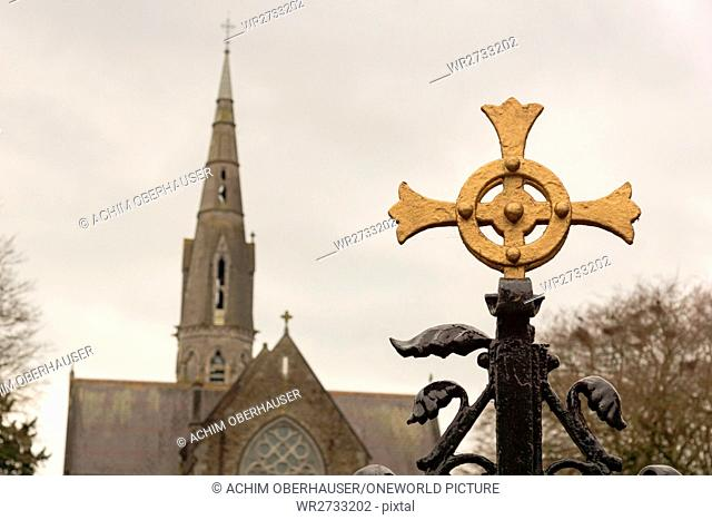 Ireland, County Meath, Cross in front of a church tower, In the city of Trim in Ireland