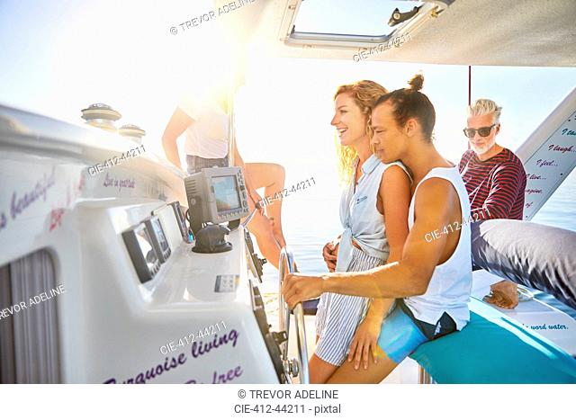 Couple at helm of boat