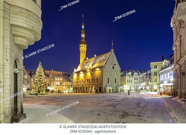Winter evening in Tallinn old town, Estonia. Town hall in the distance