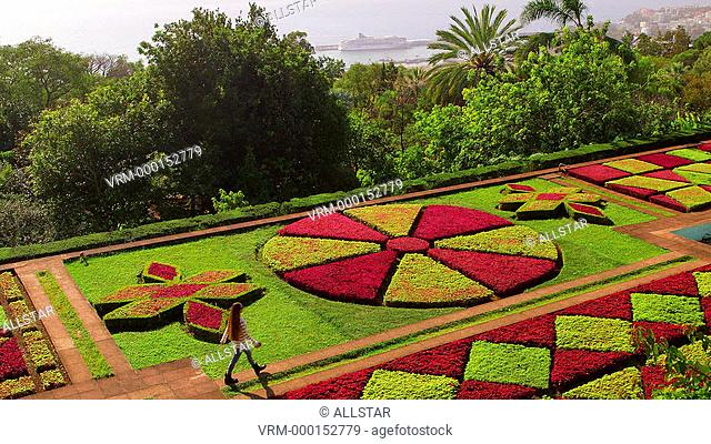 MODEL WALKS THROUGH FORMAL GARDENS; JARDIM BOTANICO, FUNCHAL, MADEIRA; 10/12/2014