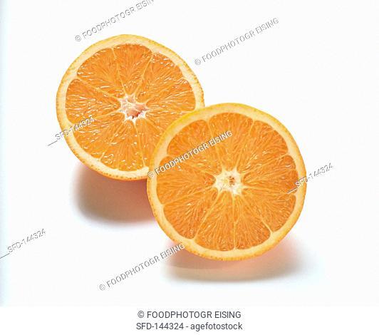 Two orange halves on white background
