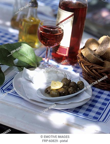Green olives with aioli and wine