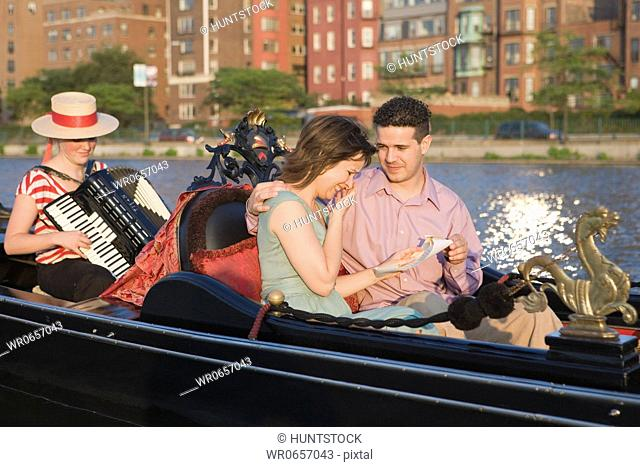 Mid adult couple romancing in a gondola