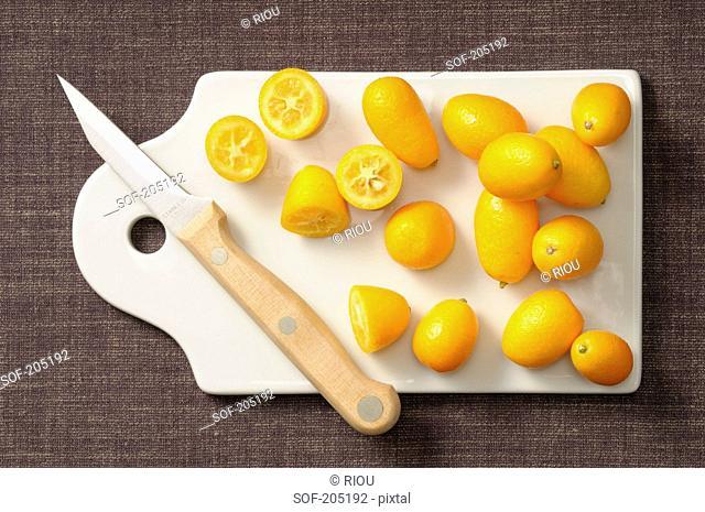 Kumquats on a chopping board