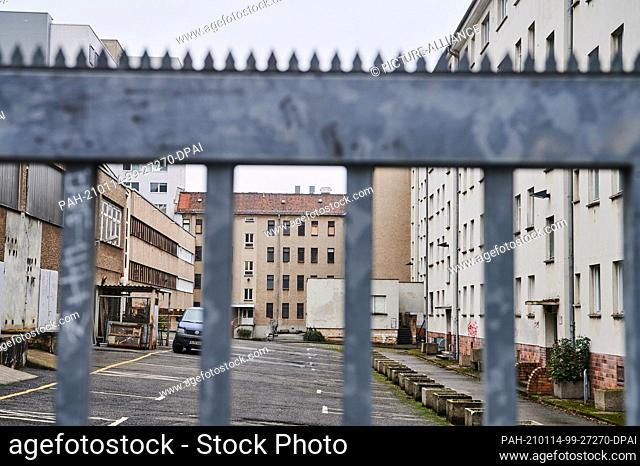 """14 January 2021, Berlin: Behind a gate, the empty houses of the former Stasi grounds can be seen. On the occasion of the anniversary of the """"""""occupation"""""""" of..."""
