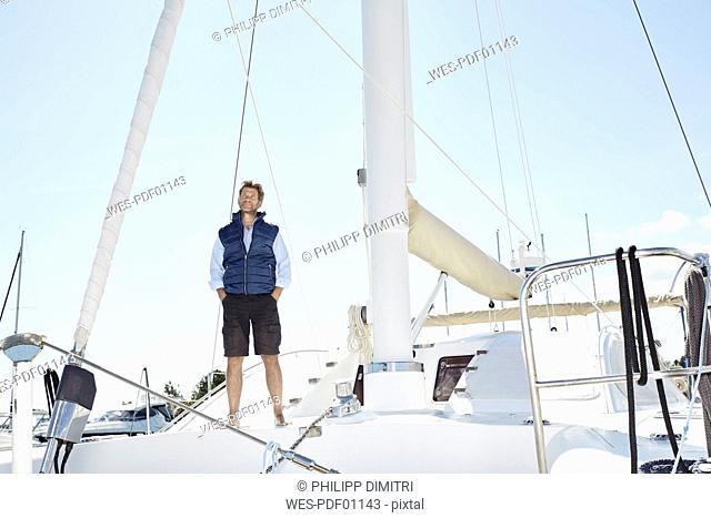 Mature man on his sailing boat