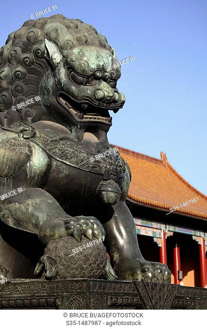 A closed up view of a bronze lion statue in front of the Gate of Supreme Harmony Tai He Men  Forbidden City  Beijing  China