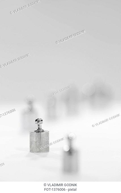 Selective focus on small metallic weight against gray background