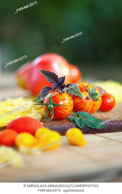 Tomato, Lycopersicon esculentum , Studio shot or red tomoatoes on wooden board